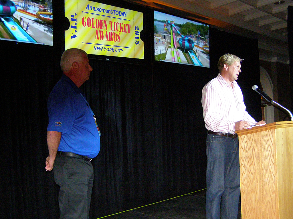 Quassy's Eric Anderson comments following acceptance of Turnstile Award while Amusement Today Publisher Gary Slade looks on.